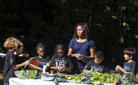 U.S. first lady Michelle Obama prepares lunch with elementary students during the annual fall harvest of the White House Kitchen Garden