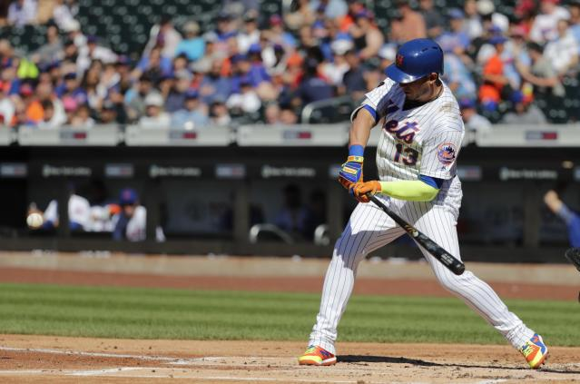 New York Mets' Asdrubal Cabrera hits a home run during the first inning in the first game of a baseball doubleheader against the Philadelphia Phillies, Monday, July 9, 2018, in New York. (AP Photo/Frank Franklin II)