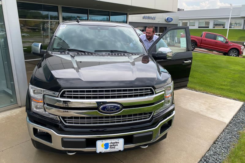 Noah Wolter, general manager of Charles Gabus Ford, shows off an F-Series truck in Des Moines