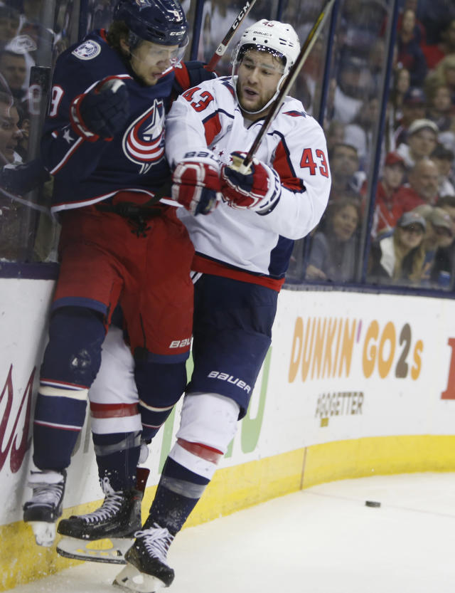 Washington Capitals' Tom Wilson, right, checks Columbus Blue Jackets' Artemi Panarin, of Russia, during the second period of Game 6 of an NHL first-round hockey playoff series Monday, April 23, 2018, in Columbus, Ohio. (AP Photo/Jay LaPrete)
