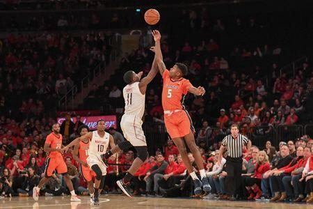 Jan 26, 2019; New York, MD, USA; Illinois Fighting Illini guard Tevian Jones (5) and Maryland Terrapins guard Darryl Morsell (11) battle for a loose ball during the second half at Madison Square Garden. Mandatory Credit: Dennis Schneidler-USA TODAY Sports