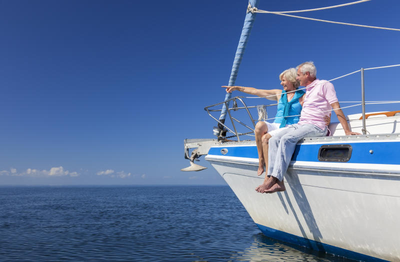 A senior couple sitting on a boat.