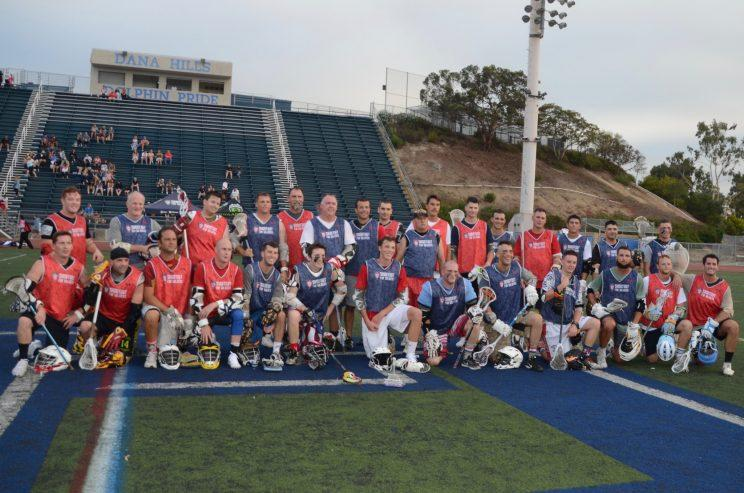A key part of Shootout for Soldiers is the forum it gives for veterans and current service members to connect. Those who played in the veteran's game posed for a picture together. (Jackie Bamberger/Yahoo Sports)