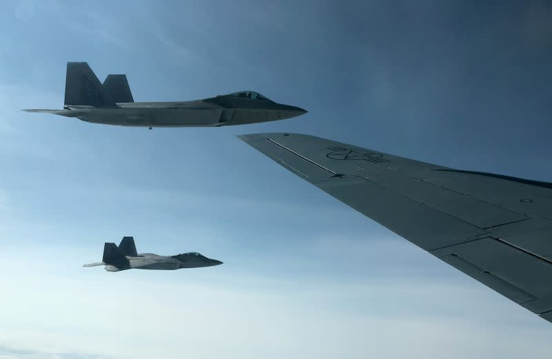 FILE PHOTO: U.S. Air Force F-22 stealth fighter jets receive fuel mid-air over Norway