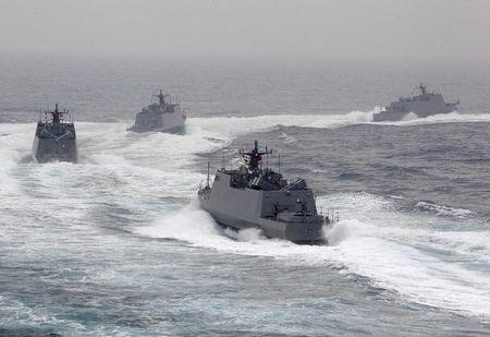 Taiwan navy fast attack boats take part in a military drill outside a naval base in Kaohsiung port