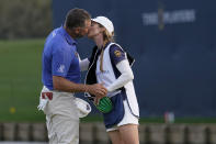 Lee Westwood, of England, kisses his fiancee and caddie, Helen Storey, on the 18th green after the third round of The Players Championship golf tournament Saturday, March 13, 2021, in Ponte Vedra Beach, Fla.(AP Photo/Gerald Herbert)