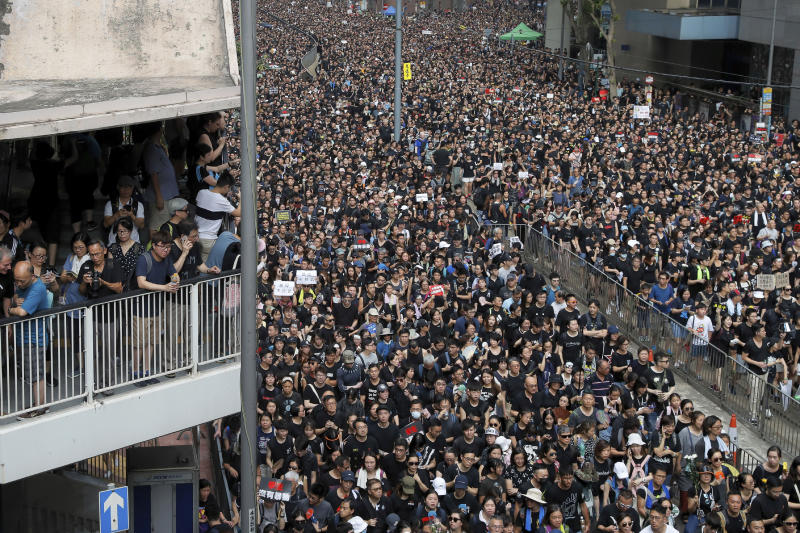 In this Sunday, June 16, 2019, photo, tens of thousands of protesters march on a street to protest against the unpopular extradition bill in Hong Kong. All but a handful of protesters in Hong Kong have gone home, but the crisis that brought nearly 2 million into the streets to oppose an extradition bill is far from over. (AP Photo/Kin Cheung)