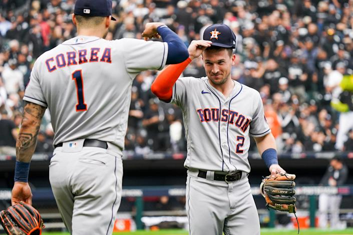 CHICAGO, IL - OCTOBER 12: Alex Bregman #2 of the Houston Astros reacts to Carlos Correa #1 in between innings during Game 4 of the ALDS between the Houston Astros and the Chicago White Sox at Guaranteed Rate Field on Tuesday, October 12, 2021 in Chicago, Illinois. (Photo by Nuccio DiNuzzo/MLB Photos via Getty Images)