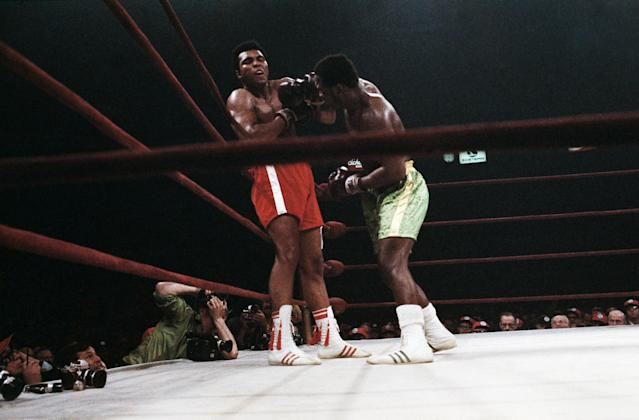 <p>Boxer Muhammad Ali, left, and Joe Frazier, center, shown in action at Madison Square Garden, New York on March 8, 1971. Ali knocked down by Joe Frazier, however Frazier won in the 15th round. Referee Art Mercante is shown on the right. (AP Photo) </p>