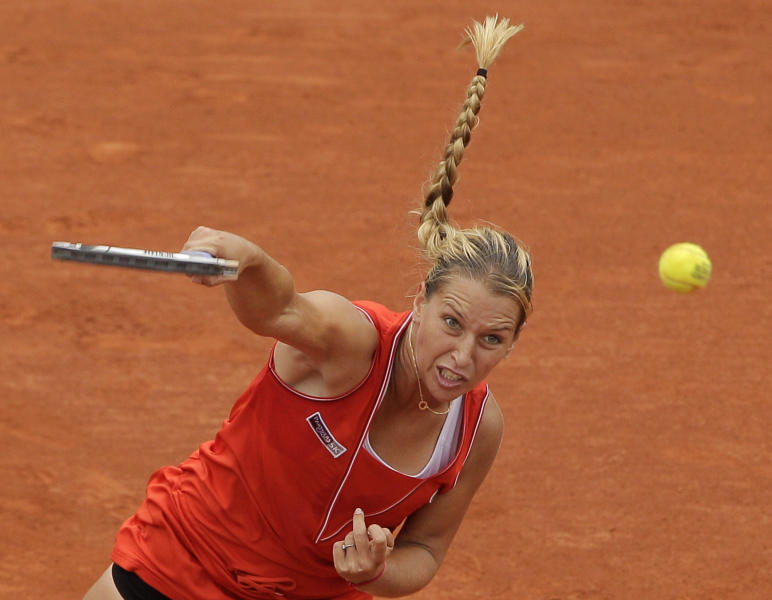 Slovakia's Dominika Cibulkova serves the ball to Belarus' Victoria Azarenka during their fourth round match in the French Open tennis tournament at the Roland Garros stadium in Paris, Sunday, June 3, 2012. (AP Photo/Michel Spingler)