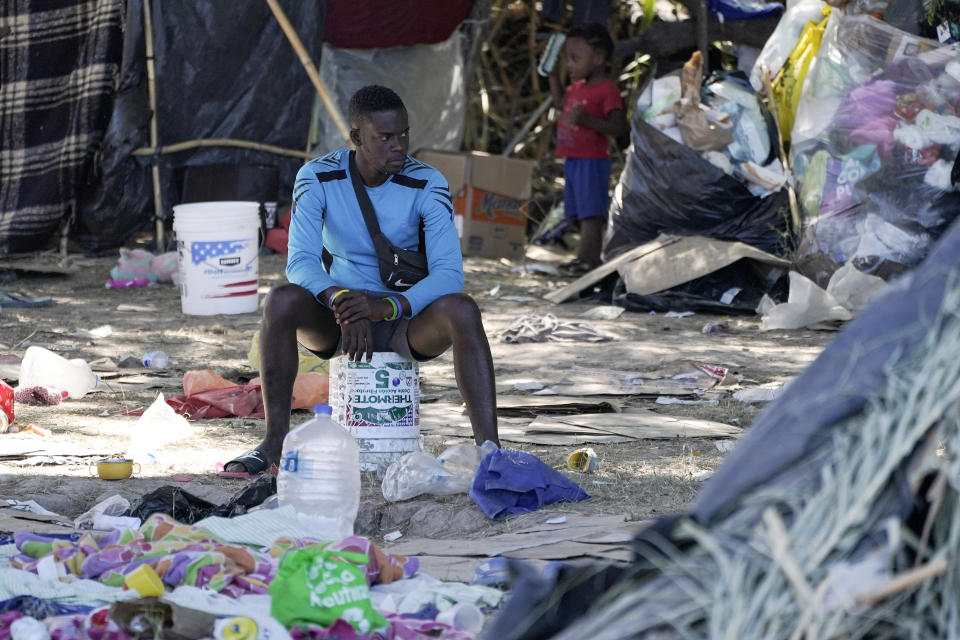 FILE - In this Sept. 23, 2021, file photo, a migrant man is seen in an encampment under the Del Rio International Bridge where migrants, many from Haiti, have been staying after crossing the Rio Grande, in Del Rio, Texas. The Border Patrol's treatment of Haitian migrants, they say, is just the latest in a long history of discriminatory U.S. policies and of indignities faced by Black people, sparking new anger among Haitian Americans, Black immigrant advocates and civil rights leaders. (AP Photo/Julio Cortez)