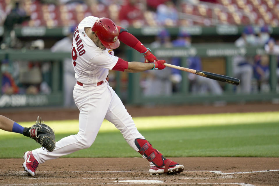 St. Louis Cardinals' Nolan Arenado hits an RBI single during the third inning in the first game of a baseball doubleheader against the New York Mets Wednesday, May 5, 2021, in St. Louis. (AP Photo/Jeff Roberson)