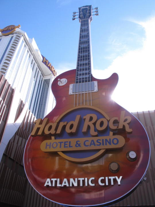 This Jan. 16, 2020, photo shows the giant guitar at the entrance to the Hard Rock casino in Atlantic City N.J. On Feb. 2, 2021, Hard Rock gave out more than $1 million in bonuses to its Atlantic City workers as a thank you for working during the coronavirus pandemic. (AP Photo/Wayne Parry)