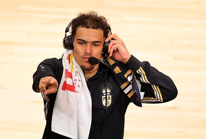 ATLANTA, GEORGIA - MAY 30:  Trae Young #11 of the Atlanta Hawks reacts prior to an interview after their 113-96 win over the New York Knicks in game four of the Eastern Conference Quarterfinals at State Farm Arena on May 30, 2021 in Atlanta, Georgia.  NOTE TO USER: User expressly acknowledges and agrees that, by downloading and or using this photograph, User is consenting to the terms and conditions of the Getty Images License Agreement.  (Photo by Kevin C. Cox/Getty Images)