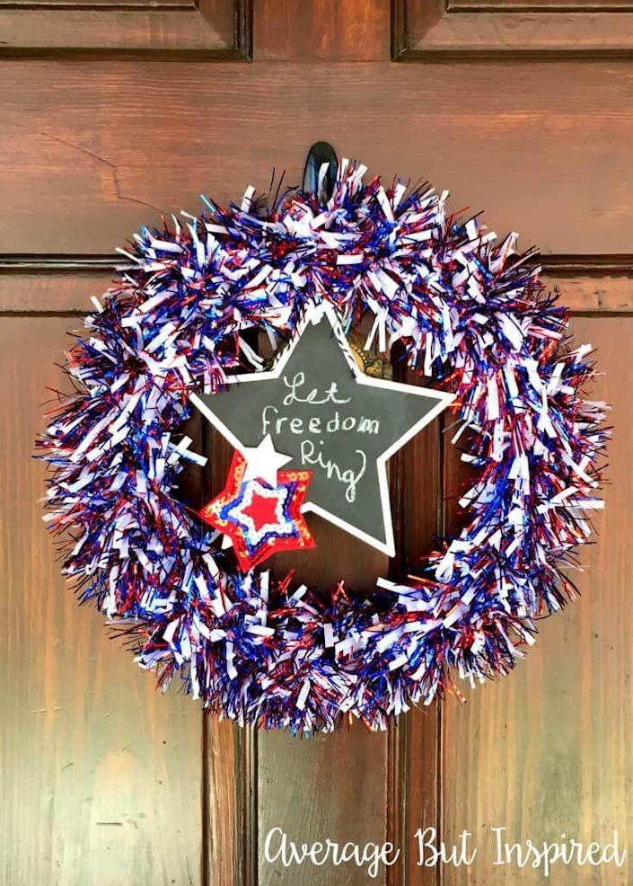 """<p>Jazz up your front door (or any door in your house) with this simple Dollar Tree patriotic wreath. </p><p><strong><em>Get the tutorial from <a href=""""https://averageinspired.com/2017/06/diy-fourth-of-july-wreath-made-with-dollar-tree-supplies.html"""" rel=""""nofollow noopener"""" target=""""_blank"""" data-ylk=""""slk:Average But Inspired"""" class=""""link rapid-noclick-resp"""">Average But Inspired</a>.</em></strong></p>"""