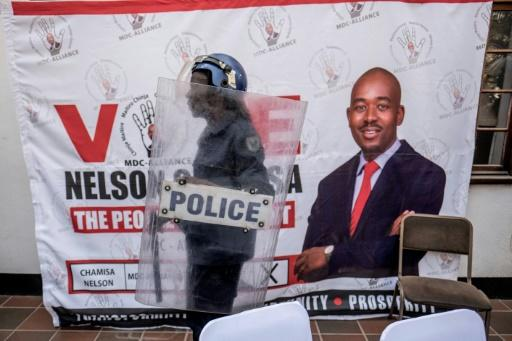Anti-riot police arrive at a Harare hotel for Chamisa's press conference