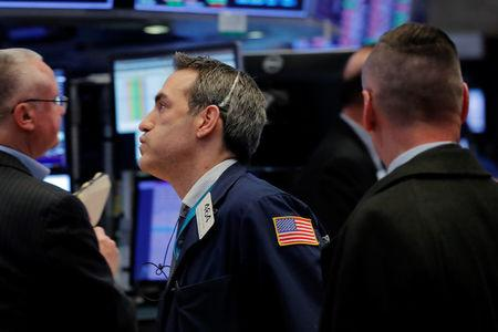 A trader works on the floor of the New York Stock Exchange shortly after the closing bell in New York