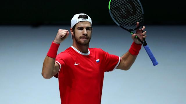 The revamped Davis Cup Finals began with defeats for defending champions Croatia and a talented Italy team.