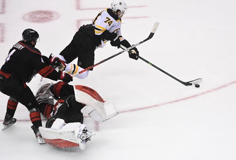DeBrusk, Bruins rally in 3rd to beat Hurricanes 4-3