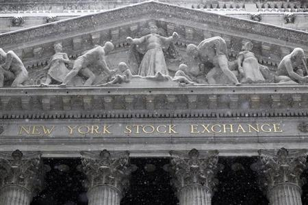 Snow falls outside the New York Stock Exchange during a winter storm in New York