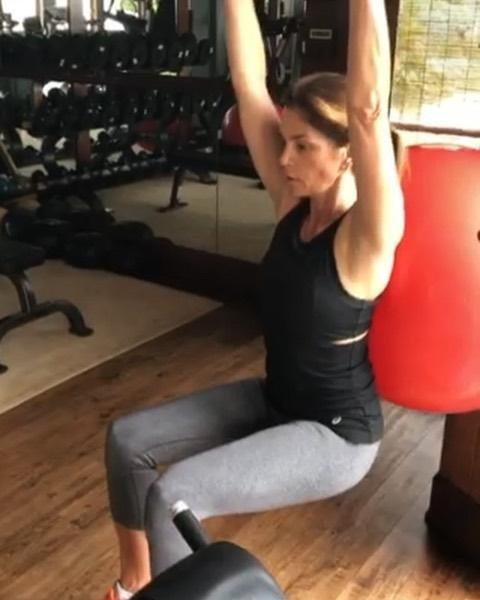 """<p>Seems subtle, but lifting her arms overhead while she performs <a href=""""https://www.womenshealthmag.com/uk/fitness/strength-training/a708464/how-to-squat-properly/"""" rel=""""nofollow noopener"""" target=""""_blank"""" data-ylk=""""slk:squats"""" class=""""link rapid-noclick-resp"""">squats</a>, means Cindy is making her abs and back muscles fire up in order to keep her core stable. It's an easy way to turn a traditional lower-body exercise into a full-body burner. Boom!</p><p><strong>RELATED: </strong>8 major benefits of <a href=""""https://www.womenshealthmag.com/uk/fitness/strength-training/a34915684/squat-everyday-benefits/"""" rel=""""nofollow noopener"""" target=""""_blank"""" data-ylk=""""slk:squatting regularly"""" class=""""link rapid-noclick-resp"""">squatting regularly</a>.</p><p><a href=""""https://www.instagram.com/p/B1Wmy9ZFtok/?utm_source=ig_embed&utm_campaign=loading"""" rel=""""nofollow noopener"""" target=""""_blank"""" data-ylk=""""slk:See the original post on Instagram"""" class=""""link rapid-noclick-resp"""">See the original post on Instagram</a></p>"""