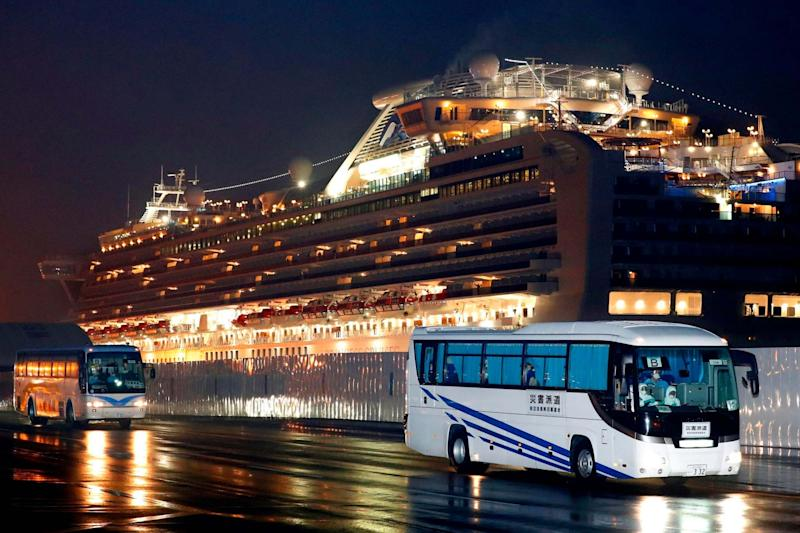 Buses carrying US passengers who were aboard the quarantined cruise ship the Diamond Princess (AP)