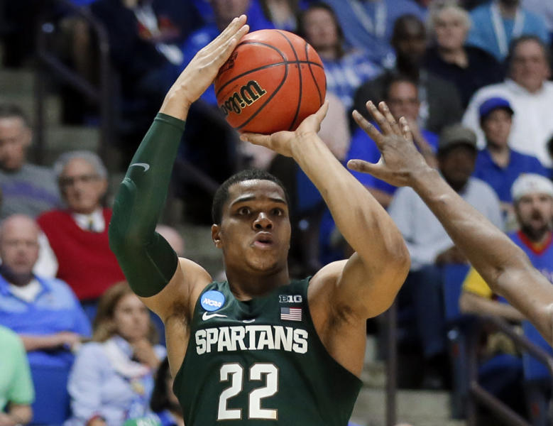 """FILE - In this March 19, 2017, file photo, Michigan State guard Miles Bridges (22) attempts a three-point basket against Kansas in the first half of a second-round game in the men's NCAA college basketball tournament, in Tulsa, Okla. Michigan State freshman standout Miles Bridges is set to announce his highly anticipated decision to stay in school or enter the NBA Draft. Bridges posted a message on his Twitter account Thursday, April 13, that read: """"Meet Me At Sparty tonight at 6 p.m. I've got something to say. It's NOT about me, It's about US."""" (AP Photo/Tony Gutierrez, File)"""