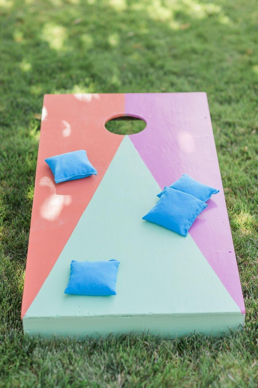 "<p>Easter pastels make this game perfectly relevant for the holiday—and what a great excuse to get outside! You could even decorate the bean bags with chicks and bunnies to extend the spring theme even further.</p><p><strong>Get the tutorial at <a href=""http://www.stylemepretty.com/living/2014/09/19/40th-birthday-fiesta/"" rel=""nofollow noopener"" target=""_blank"" data-ylk=""slk:Style Me Pretty"" class=""link rapid-noclick-resp"">Style Me Pretty</a>.</strong></p><p><a class=""link rapid-noclick-resp"" href=""https://www.amazon.com/GoSports-Solid-Wood-Premium-Cornhole/dp/B00HFAH9WU?tag=syn-yahoo-20&ascsubtag=%5Bartid%7C10050.g.3100%5Bsrc%7Cyahoo-us"" rel=""nofollow noopener"" target=""_blank"" data-ylk=""slk:SHOP CORN HOLE SETS"">SHOP CORN HOLE SETS</a></p>"