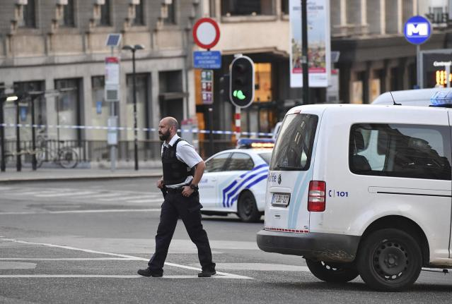 <p>A police officer walks outside Central Station after a reported explosion in Brussels on Tuesday, June 20, 2017. Belgian media are reporting that explosion-like noises have been heard at a Brussels train station, prompting the evacuation of a main square. (AP Photo/Geert Vanden Wijngaert) </p>