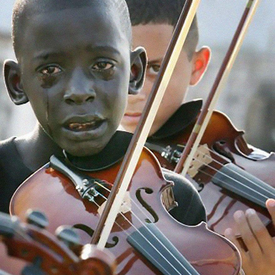 <p>2009. Brazilian 12-year-old Diego Frazão Torquato plays the violin at the funeral of his teacher, Evandro João da Silva. Da Silva helped him escape the world of drug trafficking through music.</p>