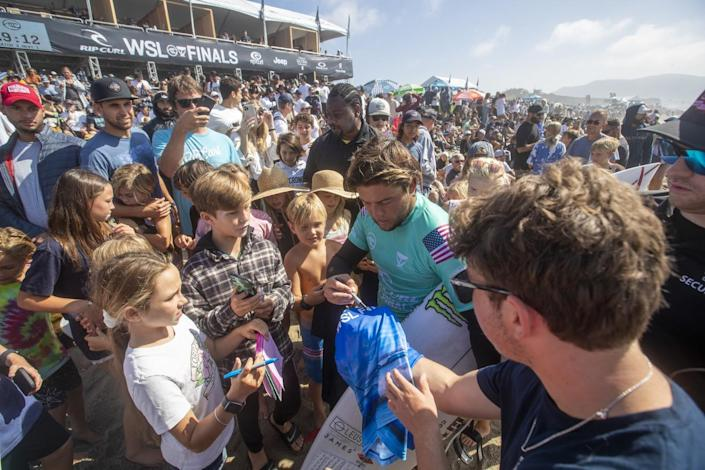 Children and other fans crowd around Conner Coffin to get autographs at the WSL Finals.