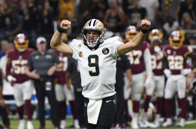 New Orleans Saints quarterback Drew Brees became the NFL's all-time passing leader on Monday night. (AP)