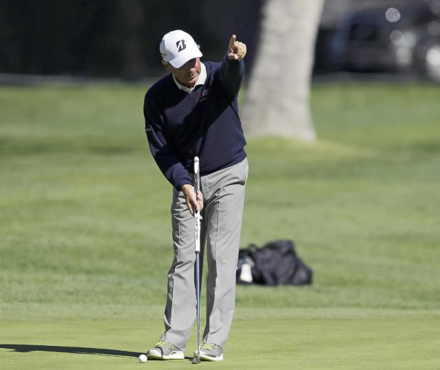 Fred Couples reacts to a partner's putt in the pro-am of the Northern Trust Open golf tournament at Riviera Country Club in the Pacific Palisades area of Los Angeles on Wednesday, Feb. 12, 2014. (AP Photo/Reed Saxon)