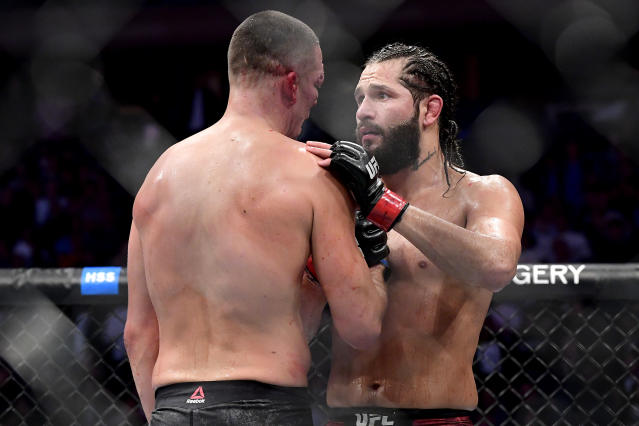 "Jorge Masvidal (R) speaks to Nate Diaz after he is awarded victory by TKO on a medical stoppage in their welterweight ""BMF"" title bout during UFC 244 at Madison Square Garden on Nov. 2, 2019 in New York City. (Getty Images)"