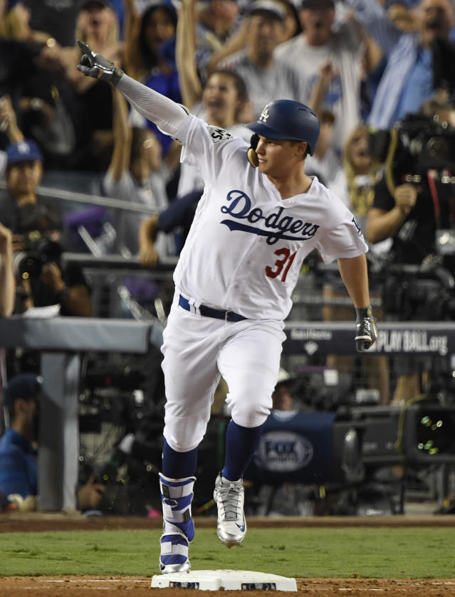 <p>Los Angeles Dodgers center fielder Joc Pederson (31) runs the bases on his solo home run against the Houston Astros in the fifth inning in game two of the 2017 World Series at Dodger Stadium. Mandatory Credit: Robert Hanashiro-USA TODAY Sports </p>