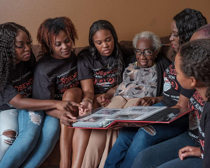 """One of the oldest living descendants of the Rosewood massacre, Altamese Wrispus, with three generations of family members. <span class=""""copyright"""">Rahim Fortune for TIME</span>"""