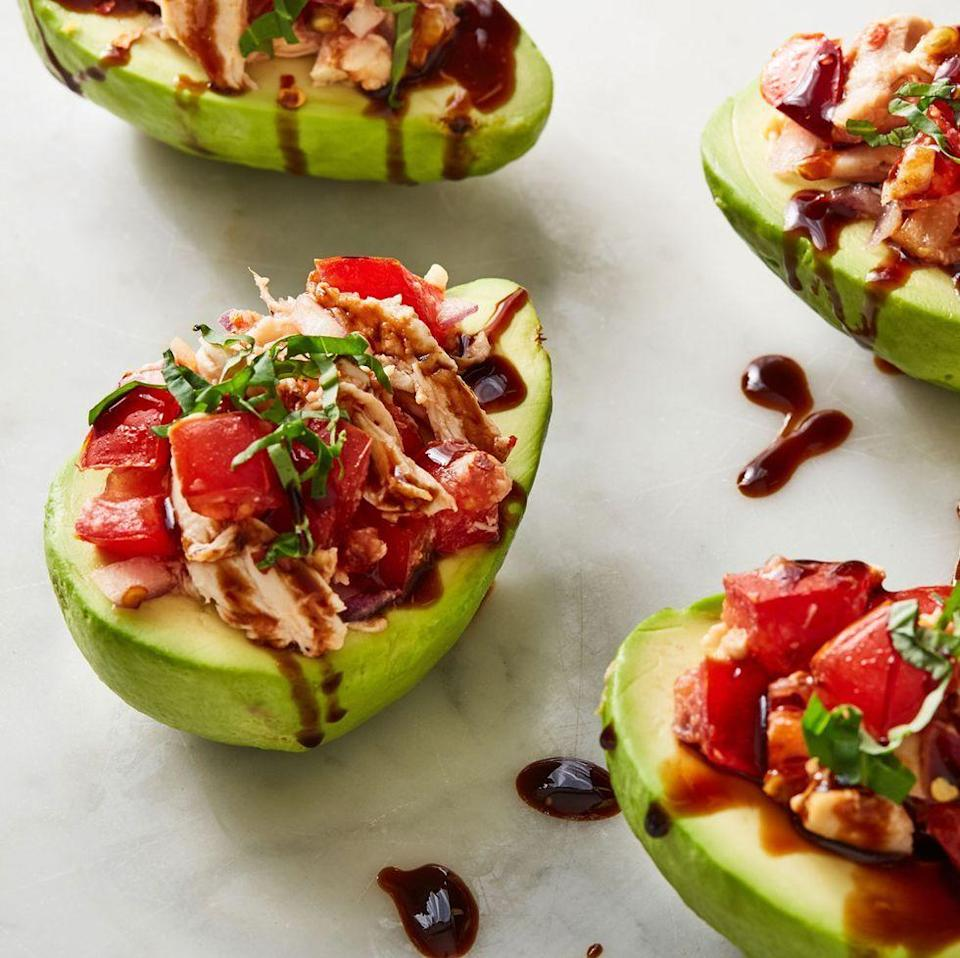 """<p><a href=""""https://www.delish.com/uk/food-news/a32968326/how-to-ripen-avocados/"""" rel=""""nofollow noopener"""" target=""""_blank"""" data-ylk=""""slk:Avocados"""" class=""""link rapid-noclick-resp"""">Avocados</a> make the perfect snack bowls. Therefore, stuffing them full of <a href=""""https://www.delish.com/uk/cooking/recipes/a34529700/bruschetta-chicken-recipe/"""" rel=""""nofollow noopener"""" target=""""_blank"""" data-ylk=""""slk:bruschetta chicken"""" class=""""link rapid-noclick-resp"""">bruschetta chicken</a> was one of easiest decisions we've ever made. </p><p>Get the <a href=""""https://www.delish.com/uk/cooking/recipes/a35041036/bruschetta-chicken-stuffed-avocados-recipe/"""" rel=""""nofollow noopener"""" target=""""_blank"""" data-ylk=""""slk:Bruschetta Chicken Stuffed Avocados"""" class=""""link rapid-noclick-resp"""">Bruschetta Chicken Stuffed Avocados</a> recipe.</p>"""