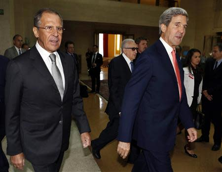 U.S. Secretary of State John Kerry and Russian Foreign Minister Sergei Lavrov walk to meeting at UN in Geneva