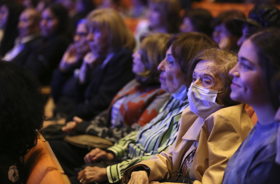Dozens of Holocaust survivors sit together for a concert honoring their lives and celebrating the end of their pandemic isolation on Monday, June 14, 2021, at the Yeshivah of Flatbush theater at Joel Braverman High School in the Brooklyn borough of New York. (AP Photo/Jessie Wardarski)