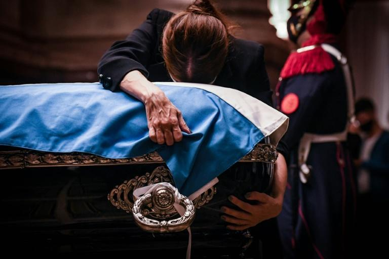 Zulema Menem embraces the coffin of her father, former Argentine president (1989-1999) Carlos Menem as he lies in state at the Congress in Buenos Aires