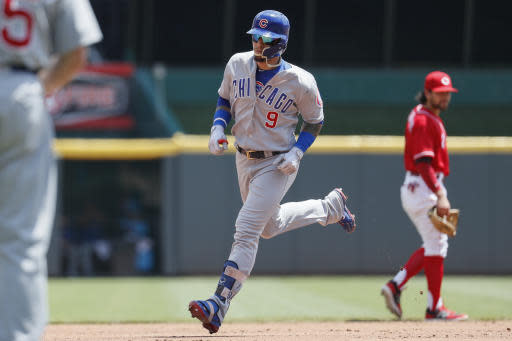 Chicago Cubs' Javier Baez (9) runs the bases after hitting a solo home run off Cincinnati Reds starting pitcher Tyler Mahle in the second inning of a baseball game, Sunday, May 20, 2018, in Cincinnati. (AP Photo/John Minchillo)