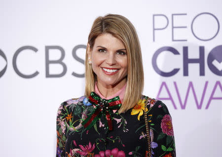 FILE PHOTO: Actress Lori Loughlin arrives at the People's Choice Awards 2017 in Los Angeles, California, U.S., January 18, 2017.  REUTERS/Danny Moloshok