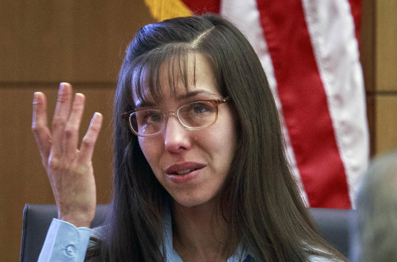 Defendant Jodi Arias tries to maintain composure as she testifies about killing Travis Alexander in 2008 during her murder trial at Judge Sherry Stephens'   Maricopa County Superior Court  in Phoenix on Wednesday, Feb. 20, 2013.   Arias is charged in the 2008 stabbing and shooting death of her lover, Alexander.  She faces the death penalty if convicted of first-degree murder.  (AP Photo/The Arizona Republic, Charlie Leight, Pool)