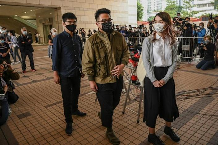 "Pro-democracy activists (L-R) Joshua Wong, Ivan Lam and Agnes Chow pleaded guilty to inciting an ""illegal assembly"" last year"