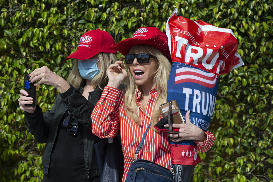 Janie Noble Simon shows her support as US President Donald Trump arrives in his motorcade in Mar-a Lago. Source: AAP