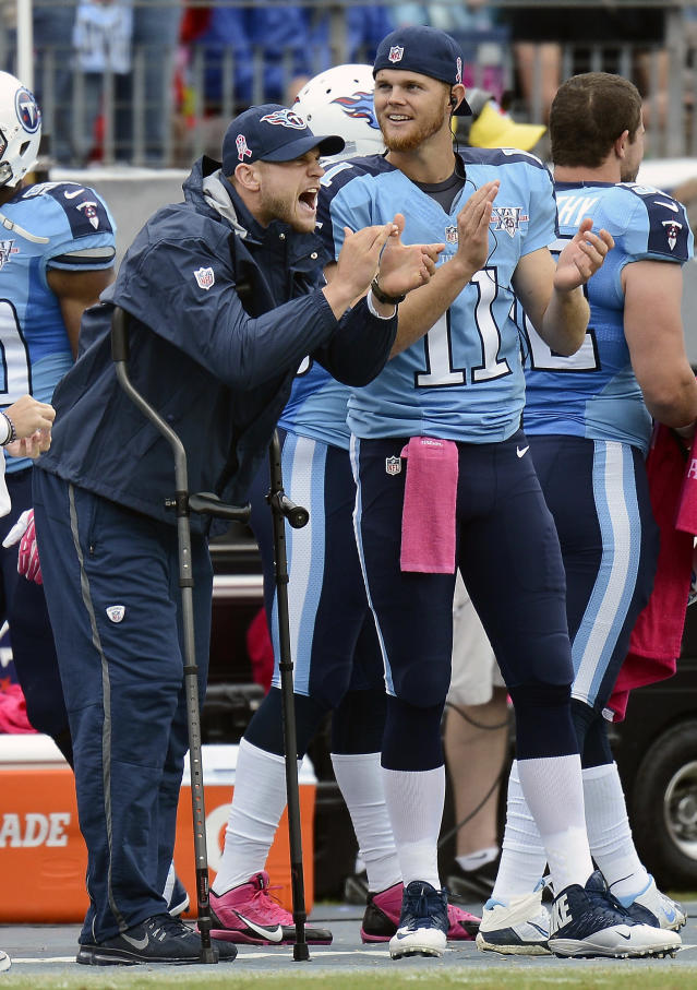 Injured Tennessee Titans quarterback Jake Locker, left, cheers along with cornerback Rusty Smith (11) during an NFL football game against the Kansas City Chiefs, Sunday, Oct. 6, 2013, in Nashville, Tenn. Locker was injured Sept. 29 while playing against the New York Jets. (AP Photo/Mark Zaleski)