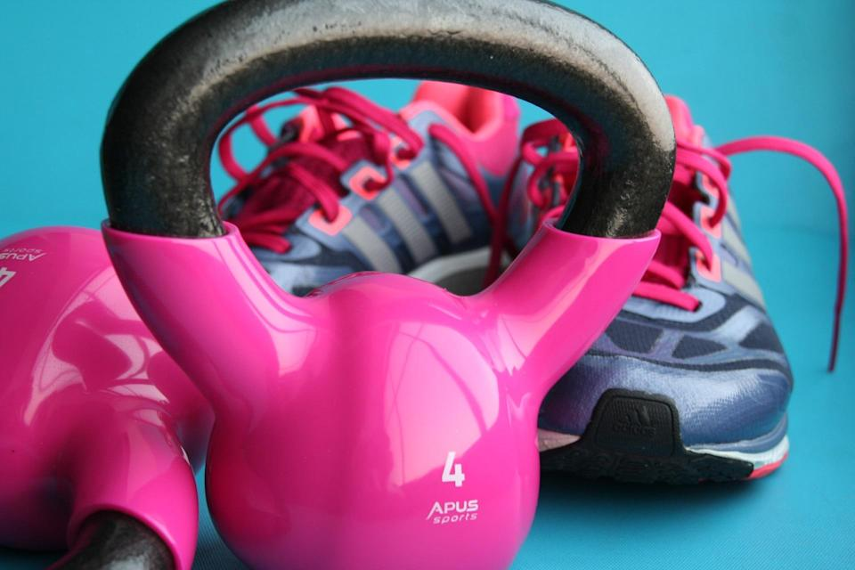 Trainers and dumbell