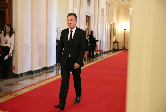 <p>Musician Bruce Springsteen walks to his seat before a ceremony awarding the Presidential Medal of Freedom to various recipients in the East Room of the White House, Nov. 22, 2016. (Carlos Barria/Reuters) </p>