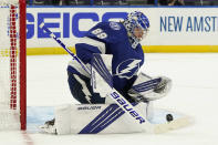 Tampa Bay Lightning goaltender Andrei Vasilevskiy (88) makes a save on a shot by the Florida Panthers during the third period in Game 3 of an NHL hockey Stanley Cup first-round playoff series Thursday, May 20, 2021, in Tampa, Fla. (AP Photo/Chris O'Meara)