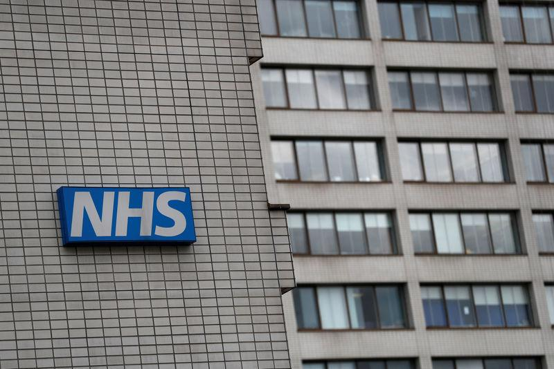 FILE PHOTO: NHS sign is seen at St Thomas' Hospital in central London